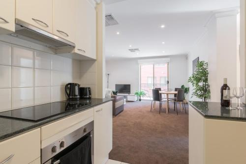 A kitchen or kitchenette at One Bedroom In Adelaide's East End FREE WIFI*Netflix*Parking