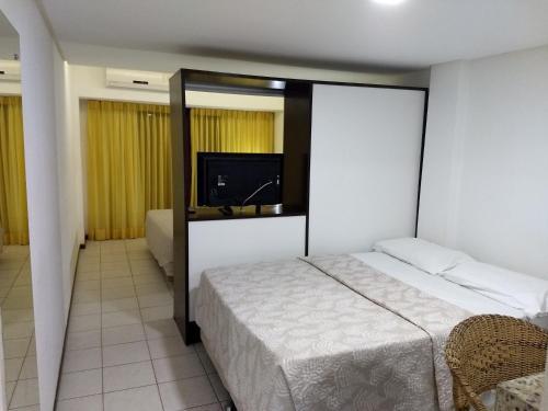 Cama ou camas em um quarto em Pipa's Bay Apartamentos