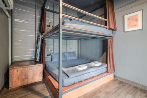 A bunk bed or bunk beds in a room at Time Sabai 134