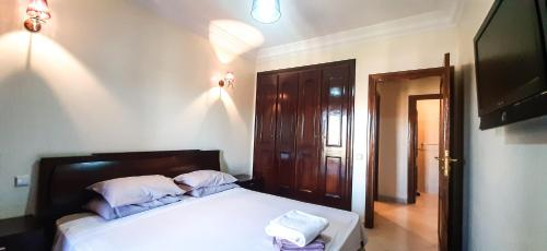 A bed or beds in a room at CAPRICE FLAT