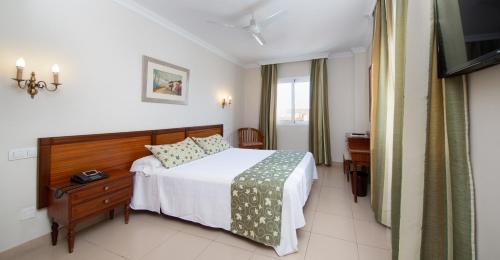 Кровать или кровати в номере Hotel Marte