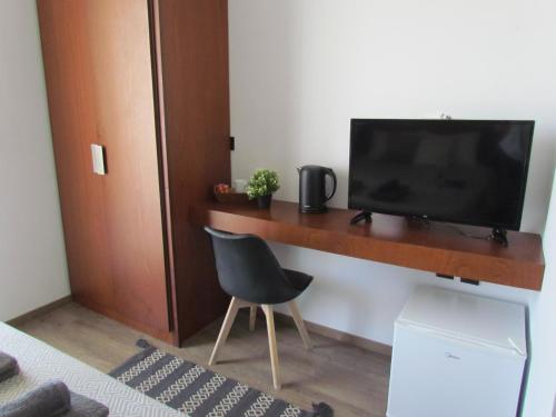 A television and/or entertainment centre at Li Mango