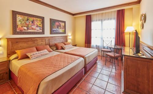 Cama o camas de una habitación en PortAventura® Hotel El Paso - Includes PortAventura Park Tickets