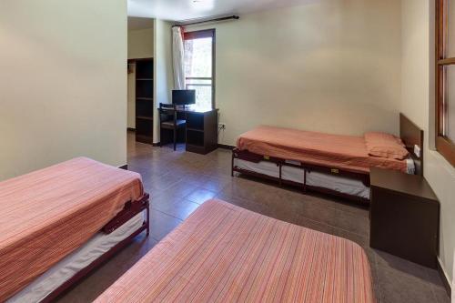 A bed or beds in a room at Alberg Les Estades
