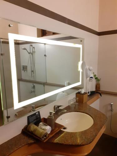 A bathroom at Cardamom County by Xandari