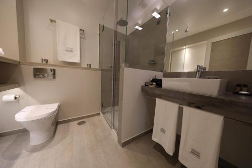 Uma casa de banho em Grande Hotel das Caldas da Felgueira