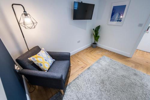 A seating area at Prosper House Apartment