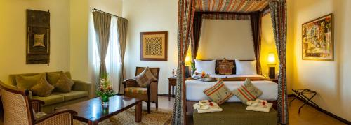 A bed or beds in a room at African Regent Hotel