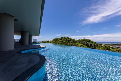 グランディスタイル 沖縄 読谷 ホテル & リゾートの敷地内または近くにあるプール