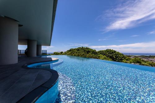 The swimming pool at or near Glamday Style Okinawa Yomitan Hotel & Resort