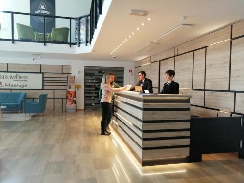 The lobby or reception area at Hotel Alpina