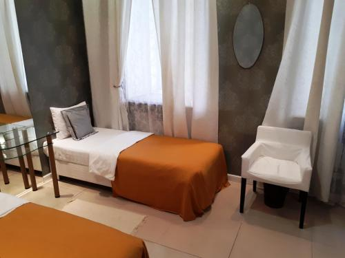 Кровать или кровати в номере Булгаков Апартаменты