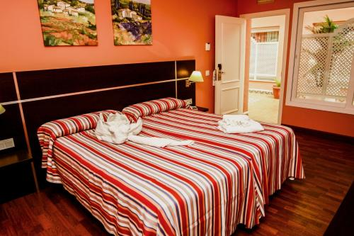 Cama o camas de una habitación en Monterrey Costa