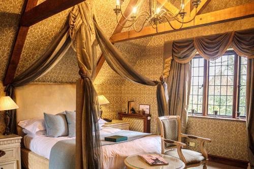 A bed or beds in a room at Langshott Manor - Luxury Hotel Gatwick