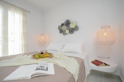 A bed or beds in a room at Naxos Hotel Poseidon