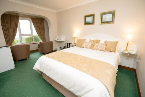 A bed or beds in a room at Arches Country House