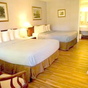 A bed or beds in a room at Travelodge by Wyndham Ogallala