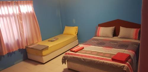 Säng eller sängar i ett rum på Om Ganesh Hostel