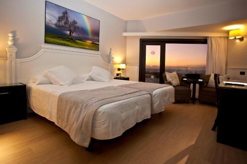 Łóżko lub łóżka w pokoju w obiekcie Hotel Vallemar