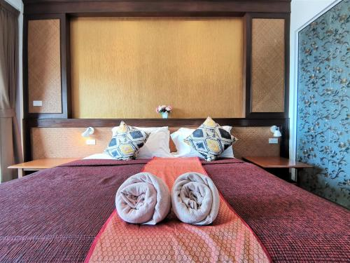 A bed or beds in a room at Lanta for Rest Boutique