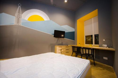 A bed or beds in a room at InWood Hostel