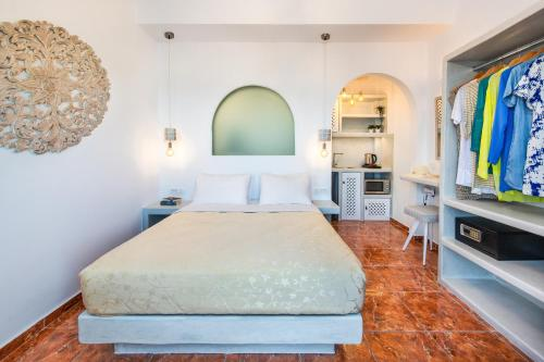 A bed or beds in a room at Nectarios Villa - Studios & Suites Adults Only