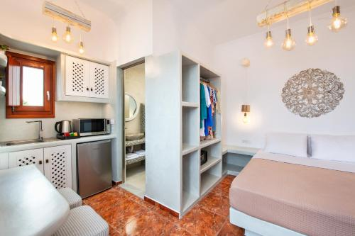 A kitchen or kitchenette at Nectarios Villa - Studios & Suites Adults Only