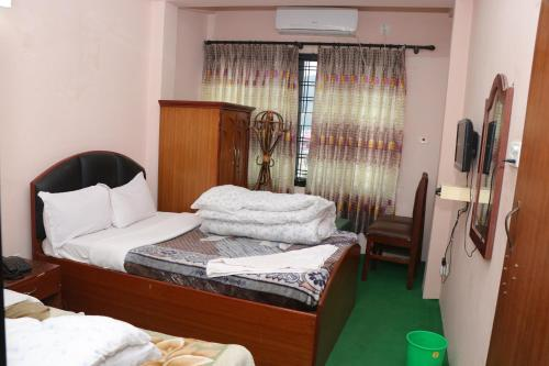 A bed or beds in a room at Hotel Venus
