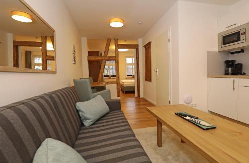 Ein Sitzbereich in der Unterkunft Aparthotel St. Marien Altstadt