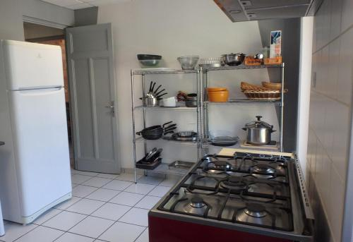 A kitchen or kitchenette at Maison 15 personnes Jardin SPA sauna