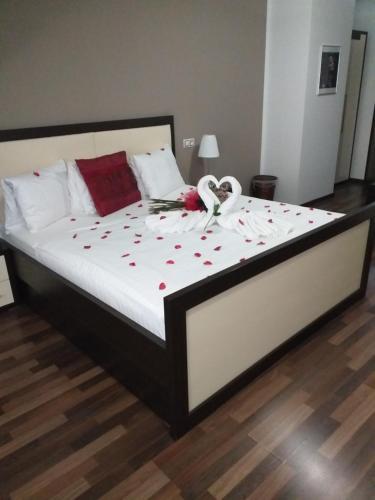 Postel nebo postele na pokoji v ubytování Hotel Corona