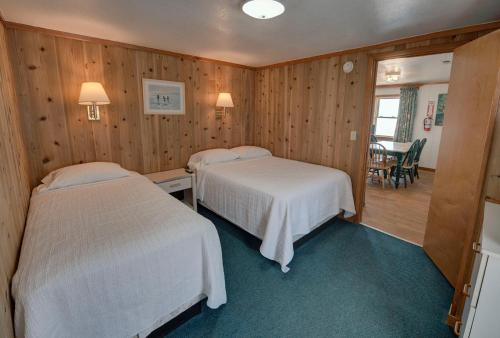 A bed or beds in a room at Outer Banks Motel