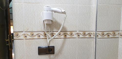 A bathroom at HOTEL AFRIQUIA GARDEN