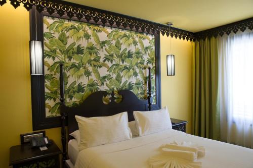 Un ou plusieurs lits dans un hébergement de l'établissement Villa Delisle Hôtel & Spa