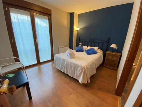 Cama o camas de una habitación en Hostal El Horno