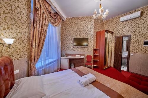 Кровать или кровати в номере Дом Никонов