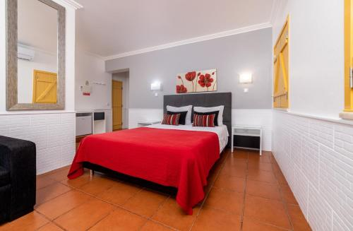 A bed or beds in a room at Rosa dos Ventos