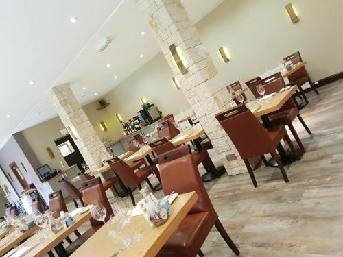A restaurant or other place to eat at Dornoch Castle Hotel