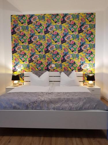 Ein Bett oder Betten in einem Zimmer der Unterkunft Hotel am Brauerei-Dreieck