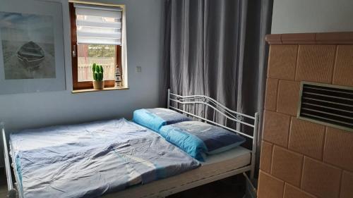Ein Bett oder Betten in einem Zimmer der Unterkunft Ferienhaus Deubetal Nr.10