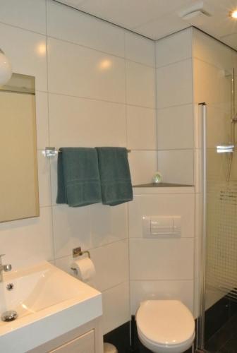 Een badkamer bij Bed&Breakfast aan Strand