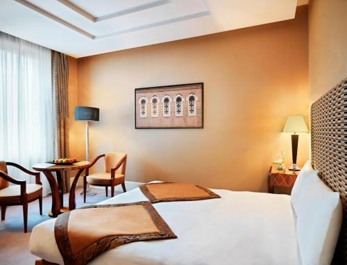 Een bed of bedden in een kamer bij Grand Hotel Via Veneto