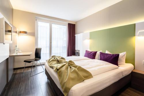 A bed or beds in a room at Hotel Demas City
