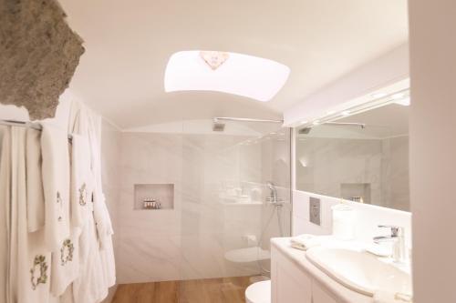 A bathroom at The Tsitouras Collection
