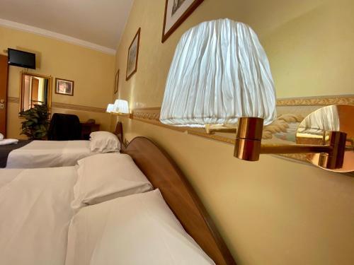 Кровать или кровати в номере Hotel Resi