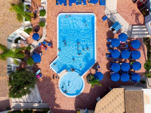A view of the pool at Villaggio Cala Mancina or nearby