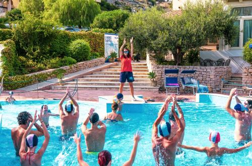 The swimming pool at or near Villaggio Cala Mancina