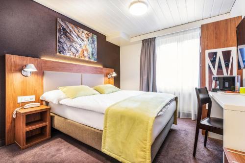 Ein Bett oder Betten in einem Zimmer der Unterkunft Campanile Martigny