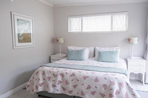A bed or beds in a room at Conifer Guest House