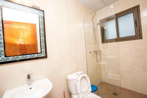 A bathroom at Residence Le Carat Bonapriso